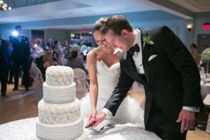 newlyweds cutting cake at Shadowland