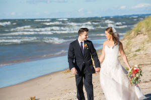 couple walking on Silver Beach in St. Joseph, MI